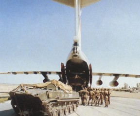 A tank being loaded in an Il-76.